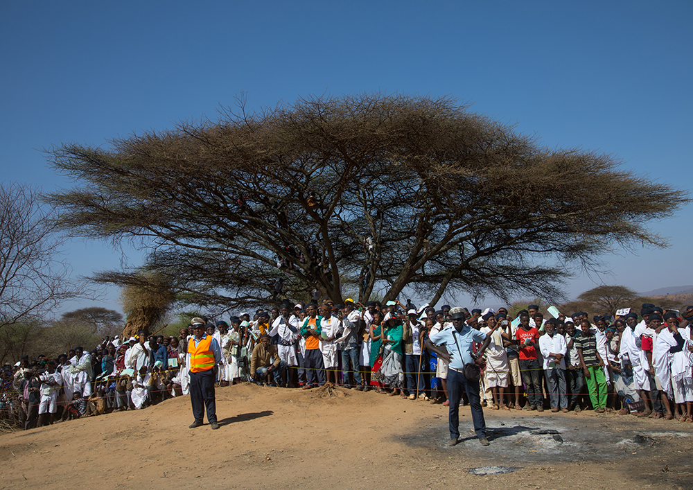 People listening to speeches during the Gada system ceremony in Borana tribe, Oromia, Yabelo, Ethiopia