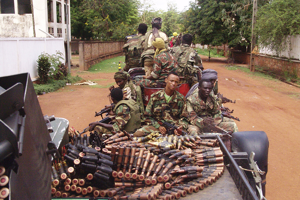 Armed fighters from the Seleka rebel alliance patrol the streets in pickup trucks to stop looting in Bangui